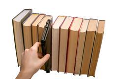 E-book vs old books - stock photo