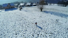 Aerial of boy skiing on home backyard 4K Stock Footage