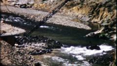 "1617 - vintage ""dragline excavator"" digs river channel - vintage film home movie Stock Footage"