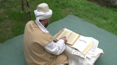 Sufi Dervish Reading Arabic - stock footage