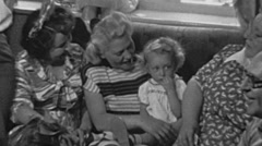 England 1950: baby celebrating her birthday at home with her relatives - stock footage