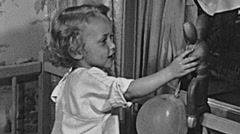 England 1950: baby girl playing at home - stock footage