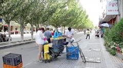 Street vendor in Jiayuguan, China Stock Footage