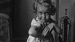 Stock Video Footage of England 1950: baby girl making funny faces