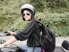 Young indian female traveler with bike. Stock Photos