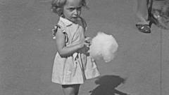 Stock Video Footage of England 1950: little girl eating cotton candy