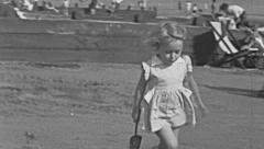 England 1950: little girl making sand castles Stock Footage