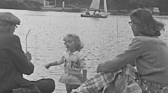 England 1950: baby, mother and grandfather at the lake - stock footage