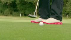Golfer making a putt - Slow Motion Stock Footage