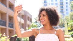 Pretty young ethnic woman taking selfie photo with cell phone Stock Footage