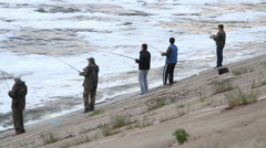 People fishing on a river Stock Footage