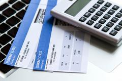 Airline ticket costs Stock Photos
