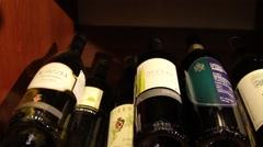 Bottles of wine on the shelves - stock footage