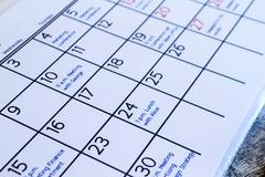 Checking monthly activities in the calendar Stock Photos