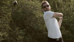 Front on shot of professional golfer teeing off - Slow motion Stock Footage