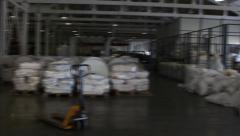 People work in large warehouse with goods at factory Stock Footage