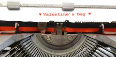 Written typewriter valentins's day with red ink Stock Photos