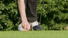 Golfer placing tee and golfball into ground - Slow motion - stock footage