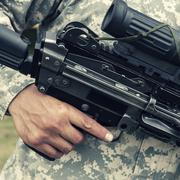 Soldier holding automatic gun Stock Photos