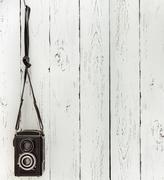 Vintage medium format photo camera on the wooden batten wall Stock Photos