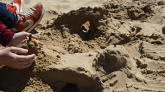 Building sand castle Stock Footage