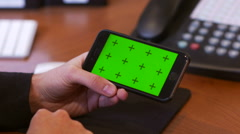 Watching Screen of iPhone 6 at Work Greenscreen - stock footage