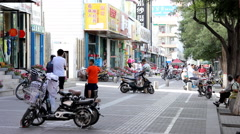Crowded sidewalk in Jiayuguan city, China - stock footage