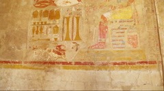 Ancient egypt color images on wall in luxor - tilt view Stock Footage