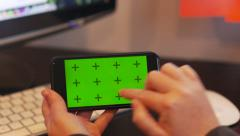 IPhone 6 Gestures Woman at Desk Greenscreen Landscape Stock Footage