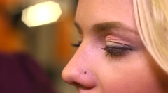 Prom night make-up - drawing shadows on the eyelids - stock footage