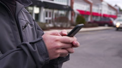 Man Typing on iPhone 6 Outside Shopping Plaza - stock footage