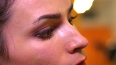 Prom night make-up artist at work - drawing shadows on the eyelids - stock footage