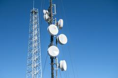 Cell phone antenna tower - stock photo
