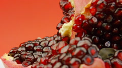 Ripe pomegranate fruit rotating on plate Stock Footage
