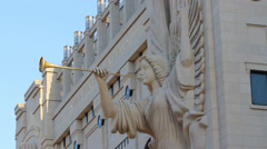 View of trumpet playing Angel statue at the Bass Performance Hall in Forth Worth Stock Footage