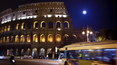 Night time lapse of the Roman Colosseum with the moon rising Stock Footage