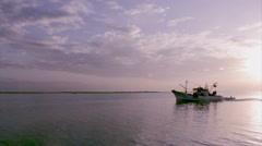 Algarve -Olhao Fishing Port Sunset B Boat silhouette - stock footage