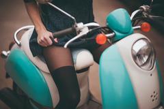 Stock Photo of girl seating on moto bike