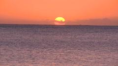 Fiji, Viti Levu, Orange Sky Sun Sets into Sea LS - stock footage