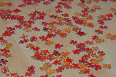 puzzle red on wooden floor Stock Photos