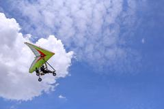 Flying motorized hang glider Stock Photos
