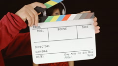 Music woman headphones clapperboard come eye Stock Footage