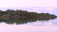 Stock Video Footage of Fiji, Viti Levu, Nayawa Village, Water and Shore LS
