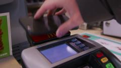 Paying with Apple Pay and iPhone 6 Stock Footage