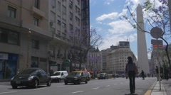 Central street in Buenos Aires at the bottom Obelisk Stock Footage