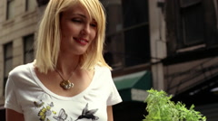 Young urban woman on her bicycle with organic vegetables in shopping bag Stock Footage