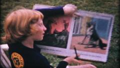 1619 - art work by little, shows to the camera - vintage film home movie Stock Footage