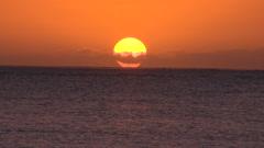 Fiji, Viti Levu, Orange Sky Sun Sets into Sea MS - stock footage