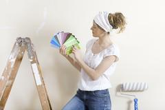 Women looking for wall color Stock Photos
