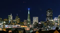 Time Lapse of Victorian Houses & Skyline in San Francisco at Night -Zoom Out- - stock footage